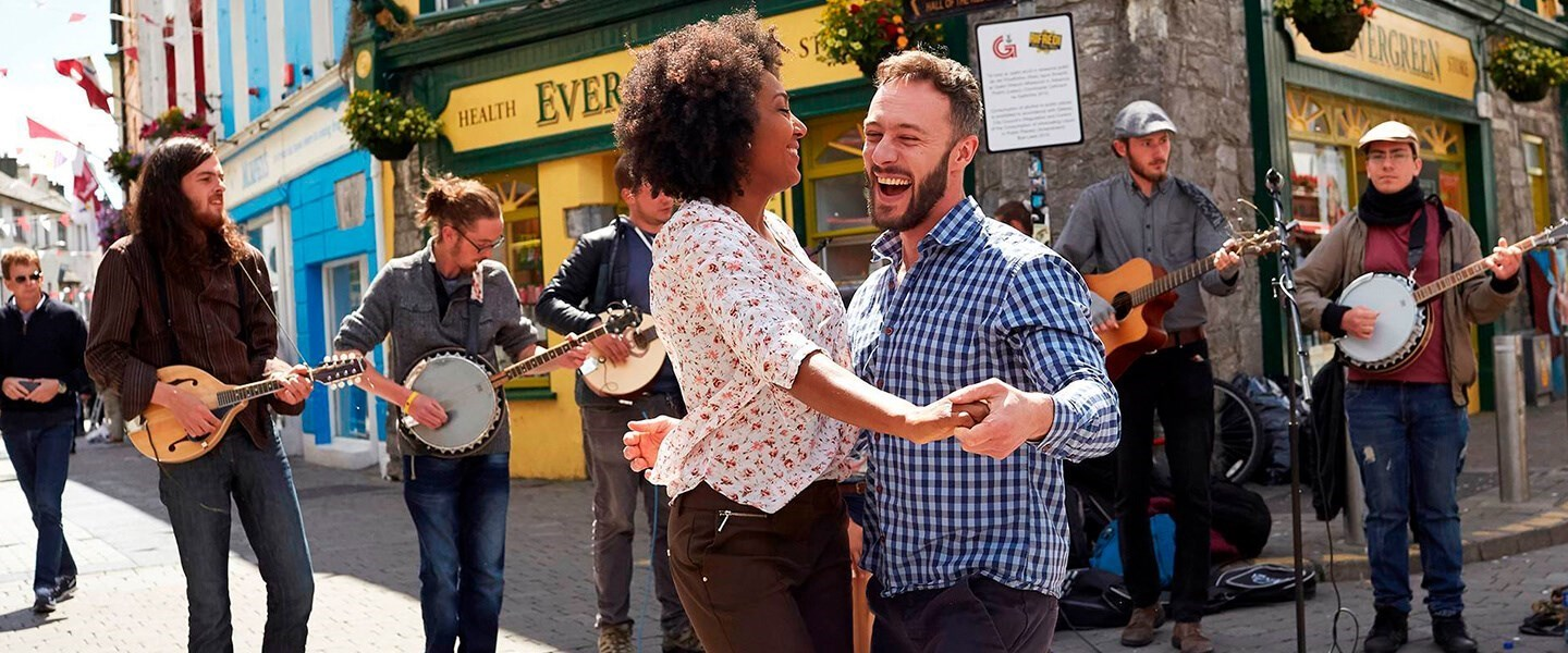 Couple dancing to Irish music in the street