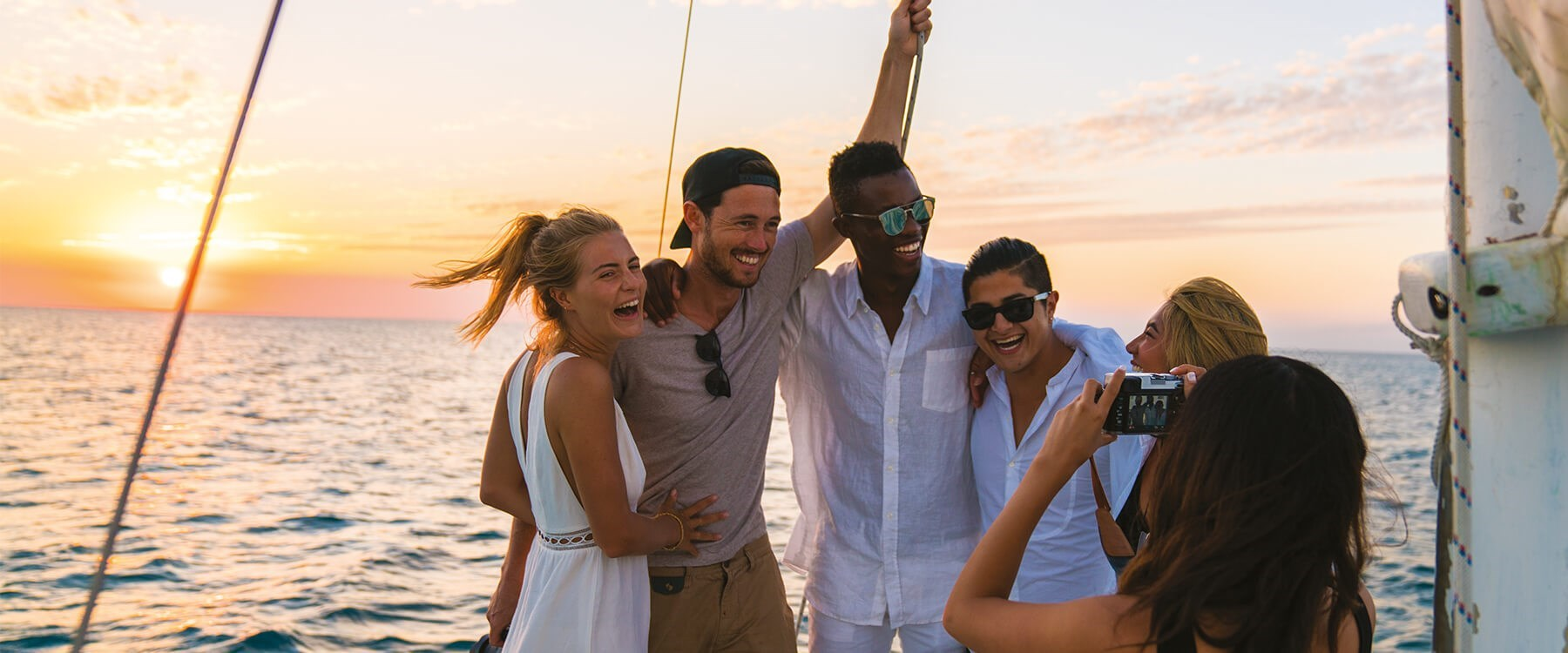 Group of young travellers on a yacht.